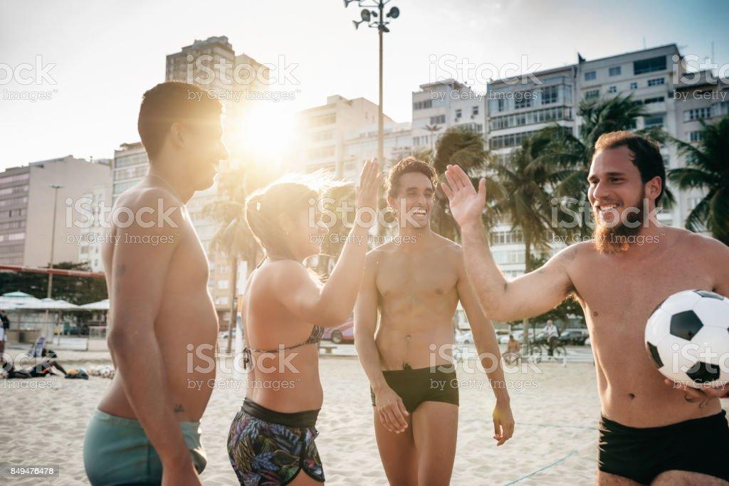 brazilian sportspeople giving high five stock photo