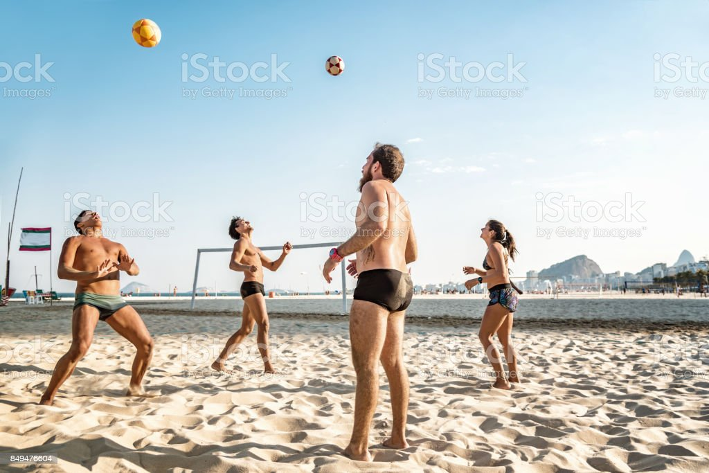 brazilian sportspeople playing footvolley at beach in Rio de Janeiro stock photo