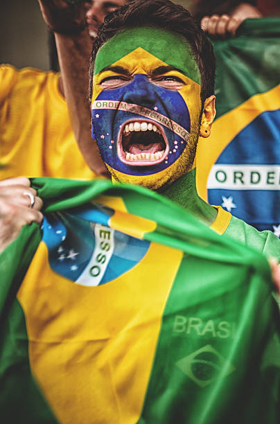 Brazilian supporter with brazil flag stock photo