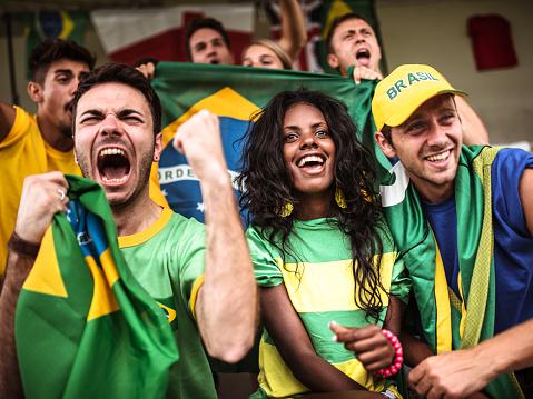 Brazilian supporters cheering at stadium