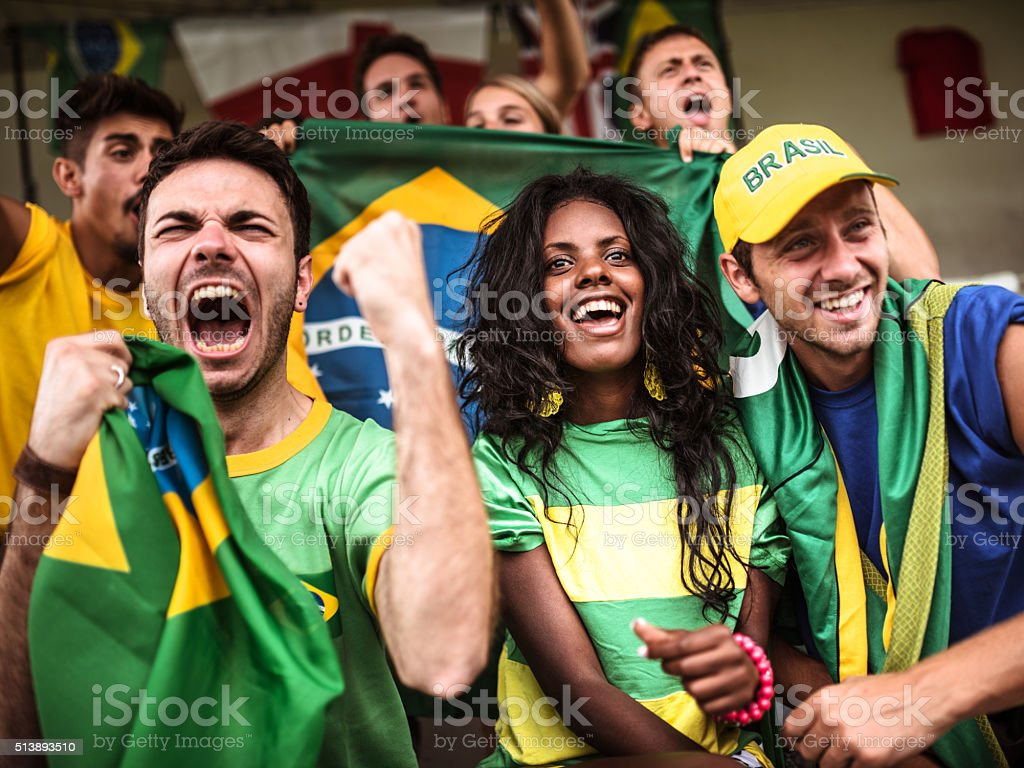 Brazilian supporters cheering at stadium stock photo