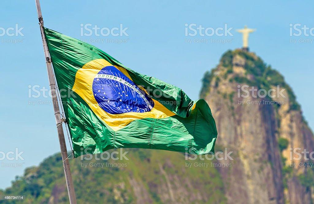 Brazilian waving flag on Rio de Janeiro, Brazil stock photo