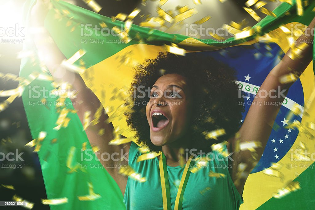 Brazilian woman celebrating in the stadium stock photo