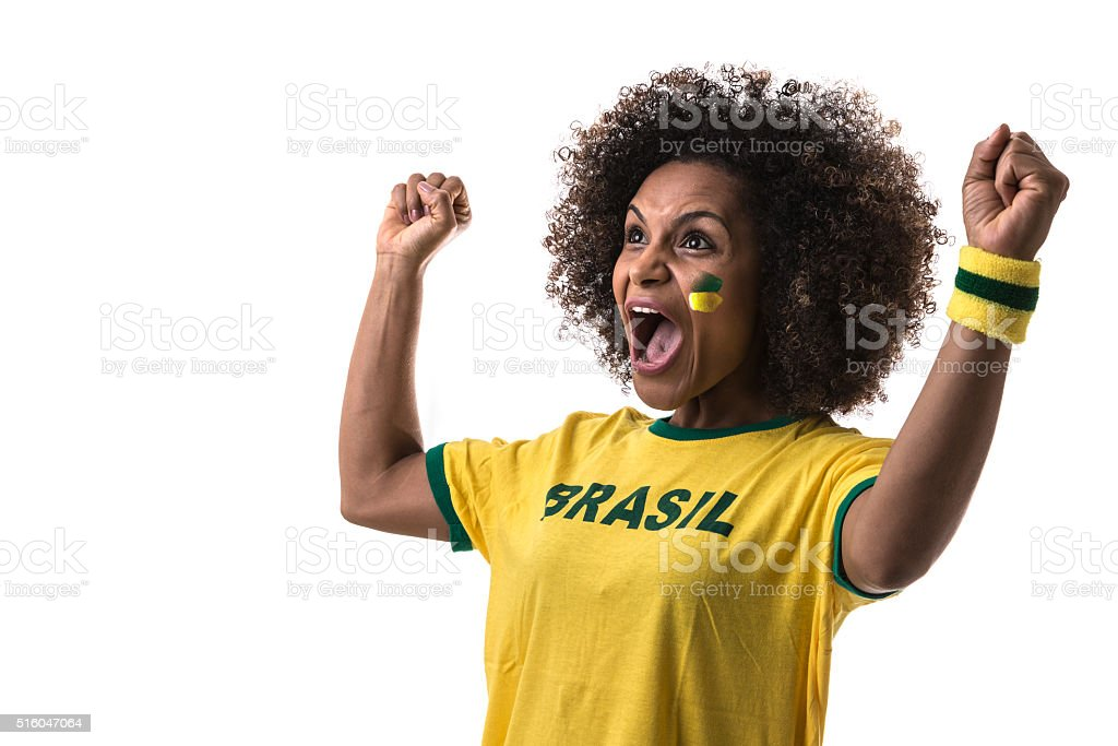 Brazilian woman celebrating on white background stock photo