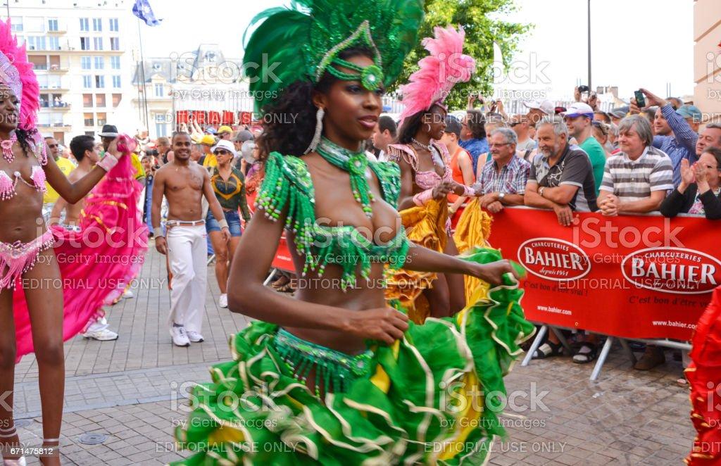 LE MANS, FRANCE - JUNE 13, 2014: Brazilian woman dancing samba at a parade in Le mans stock photo
