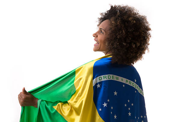 Brazilian woman holding the flag of Brazil stock photo