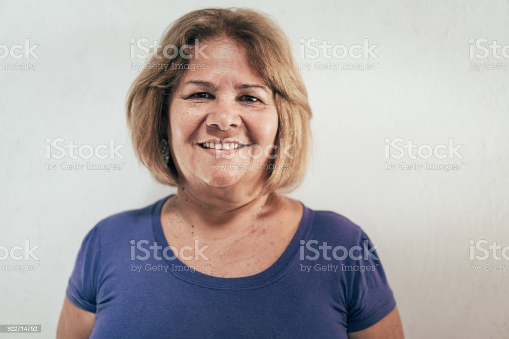 brazilian woman in front of white wall stock photo