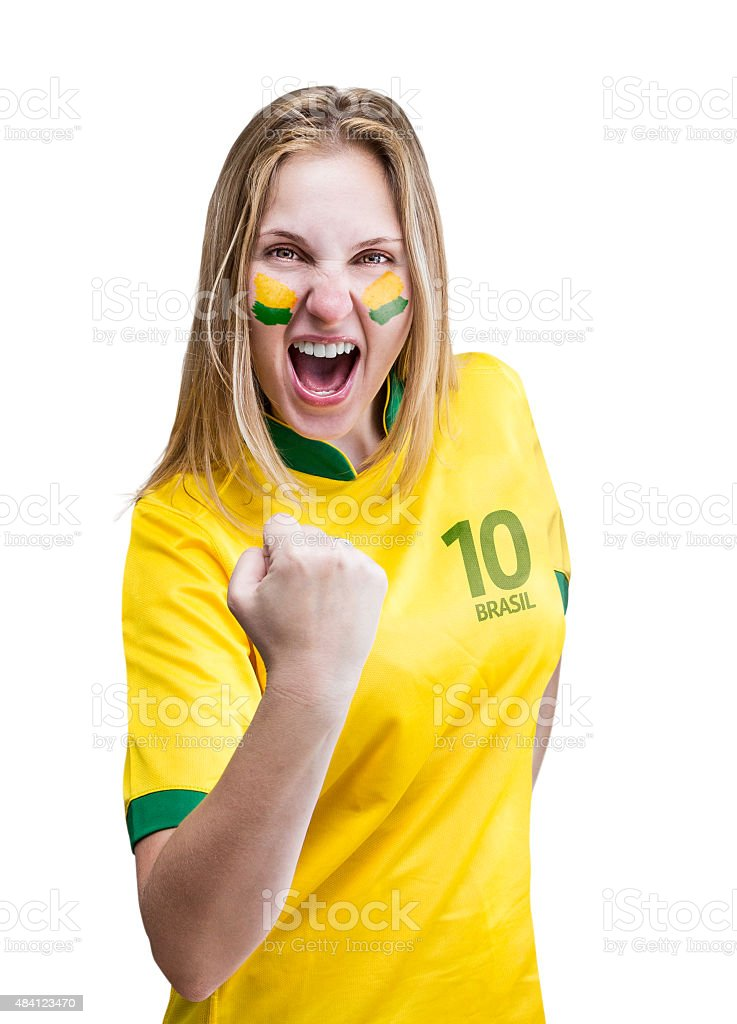 Mulher Jogador de futebol brasileiro celebra em fundo branco - foto de acervo