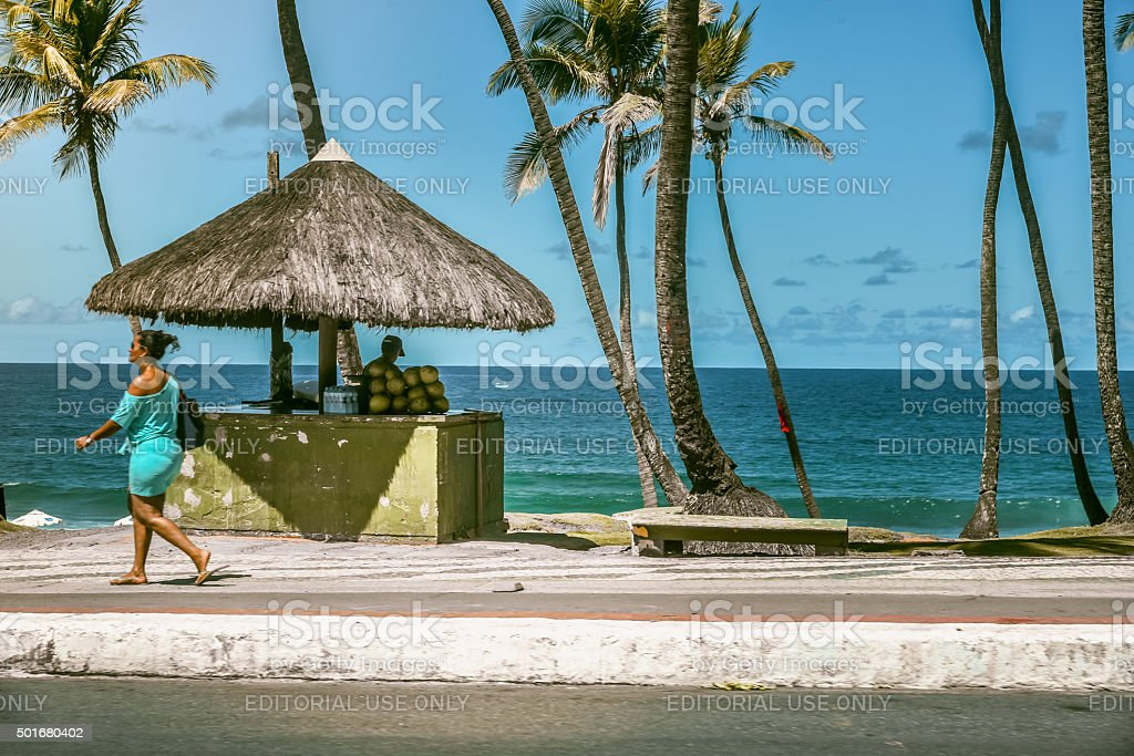 brazilian woman walking at coast promenade in Salvador da Bahia stock photo
