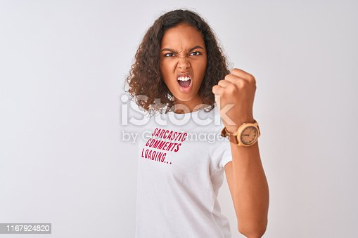 808681534 istock photo Brazilian woman wearing fanny t-shirt with irony comments over isolated white background annoyed and frustrated shouting with anger, crazy and yelling with raised hand, anger concept 1167924820