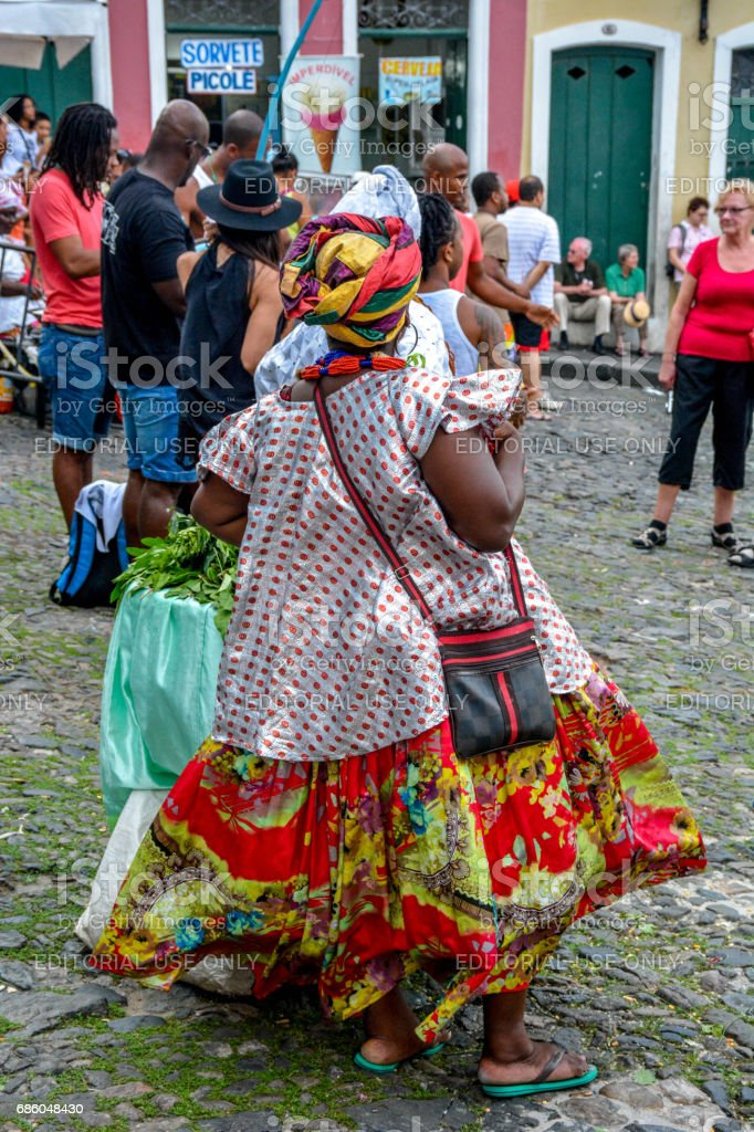 Brazilian woman wearing traditional clothes from Bahia in the old colonial district of Salvador stock photo