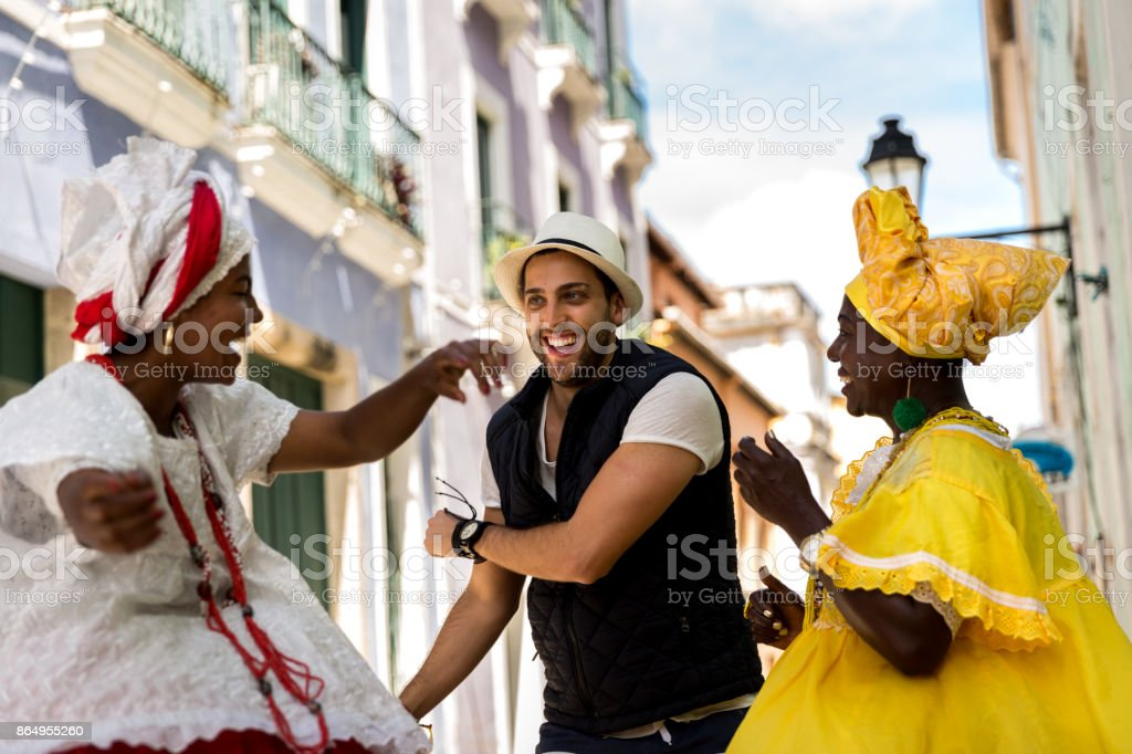 Brazilian women 'Baiana' dancing in Pelourinho, Salvador, Bahia, Brazil stock photo