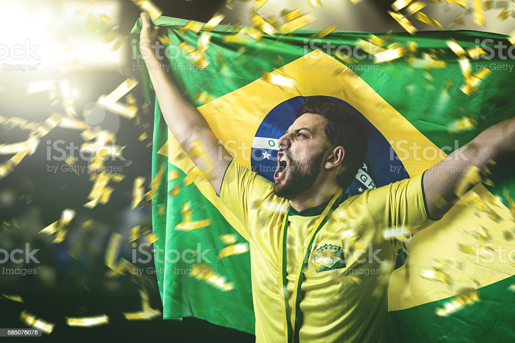 Brazilian young athlete celebrating in the stadium - foto de acervo