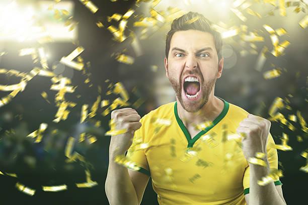 Brazilian young athlete celebrating in the stadium - foto de acervo