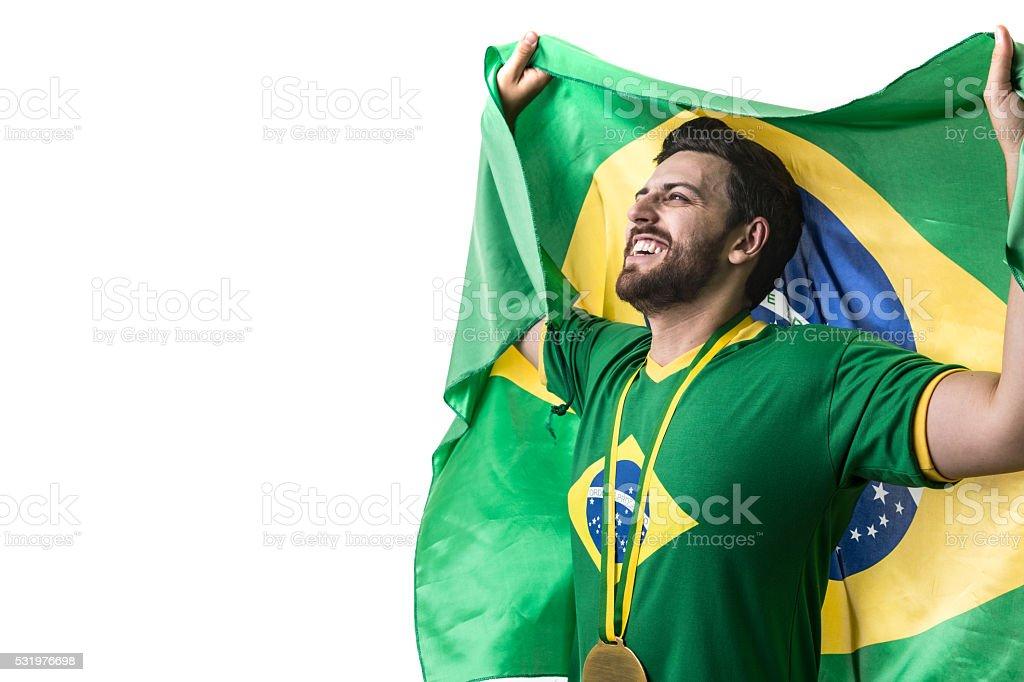 Jovens torcedores brasileiros segurando bandeira do Brasil no fundo branco - foto de acervo