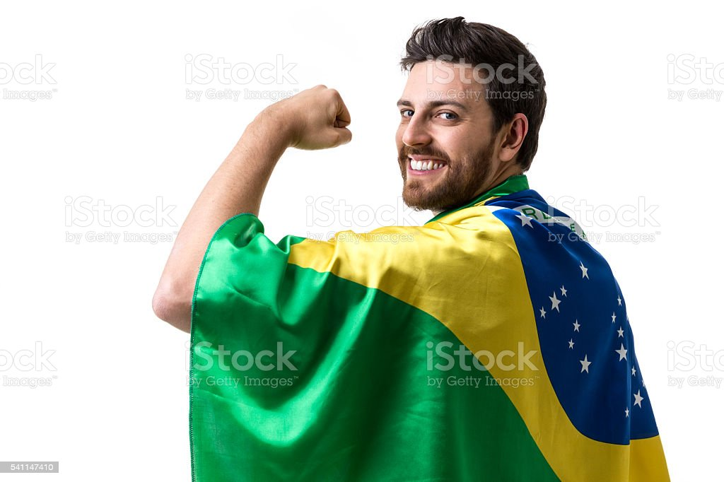 Brazilian young holding flag Brazil on white background - foto de acervo