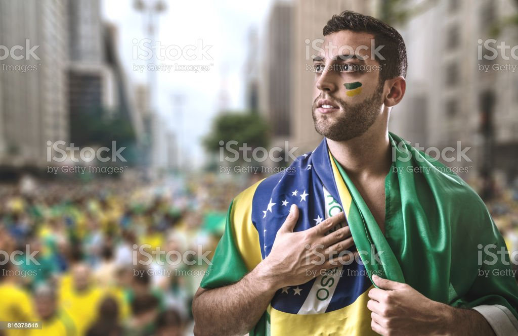 Brazilian young man holding the flag in Sao Paulo stock photo