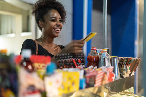 Brazilian young woman buying some street products stock photo