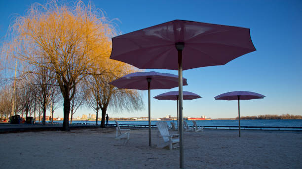 breach chairs with umbrella in sunset colour stock photo
