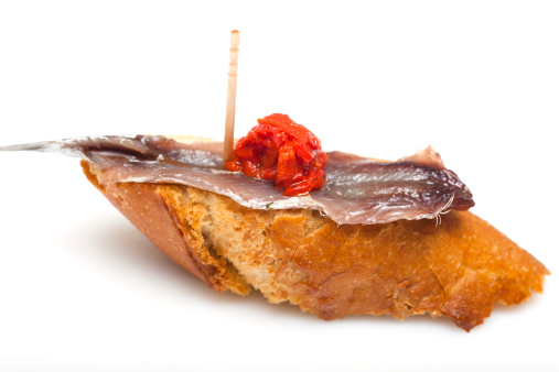Bread and anchovy tapa