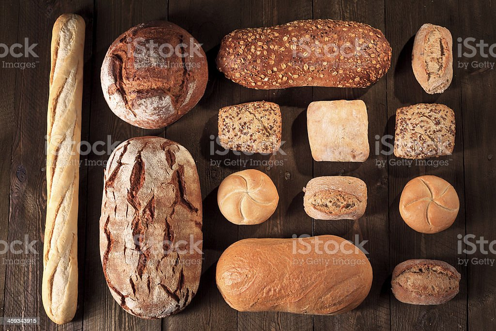 Bread and buns on wooden table, Bakeries stock photo
