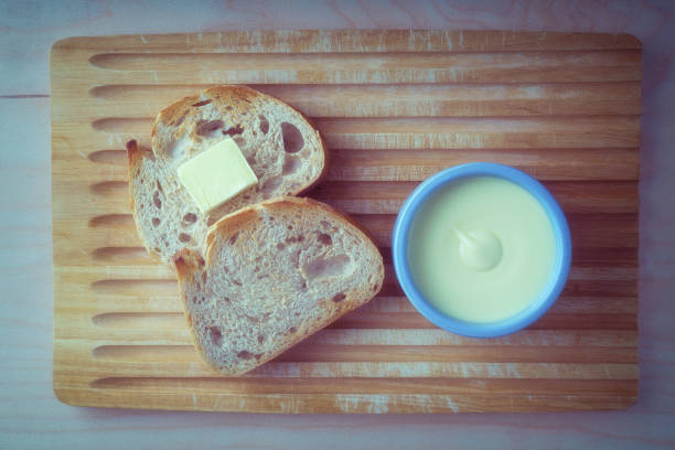 Bread and butter on a bread Board stock photo