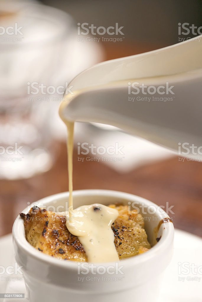 Bread and Butter Pudding with Sauce stock photo