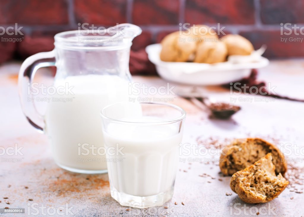 bread and milk on a table stock photo