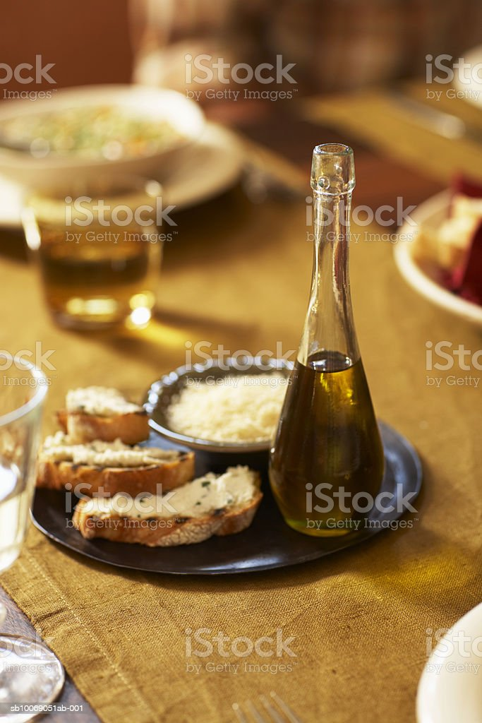 Bread and olive oil on table foto de stock libre de derechos