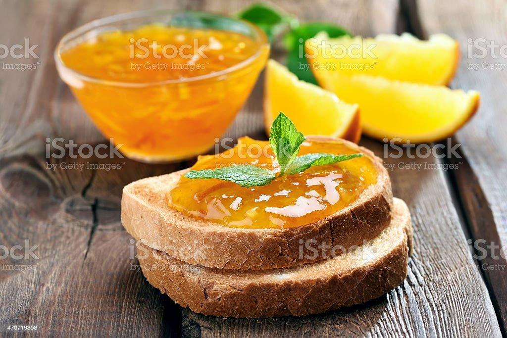 Bread and orange jam stock photo