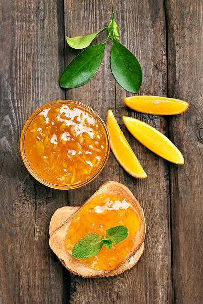 Bread and orange jam, top view stock photo