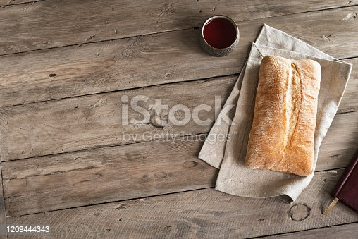 Bread and Red Wine on wooden table, copy space.