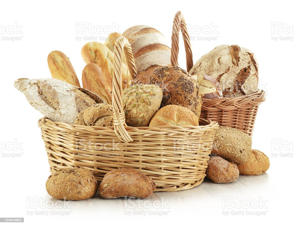 Bread and rolls in wicker baskets isolated on white stock photo