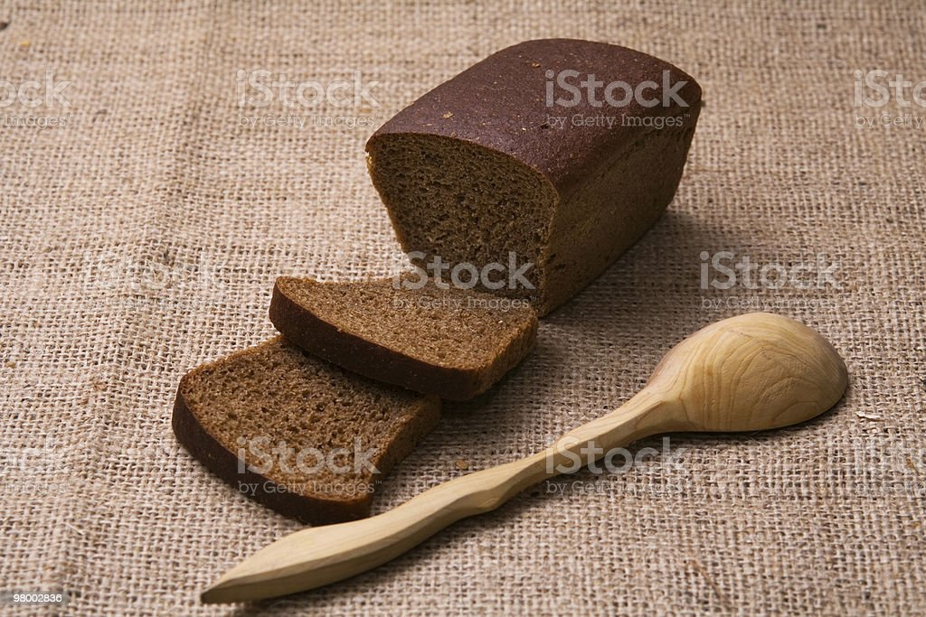 Bread and spoon royalty-free stock photo