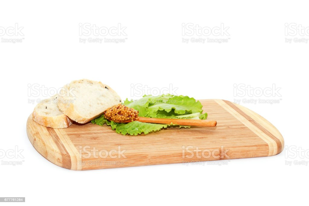 Bread and spoon with mustard royalty-free stock photo