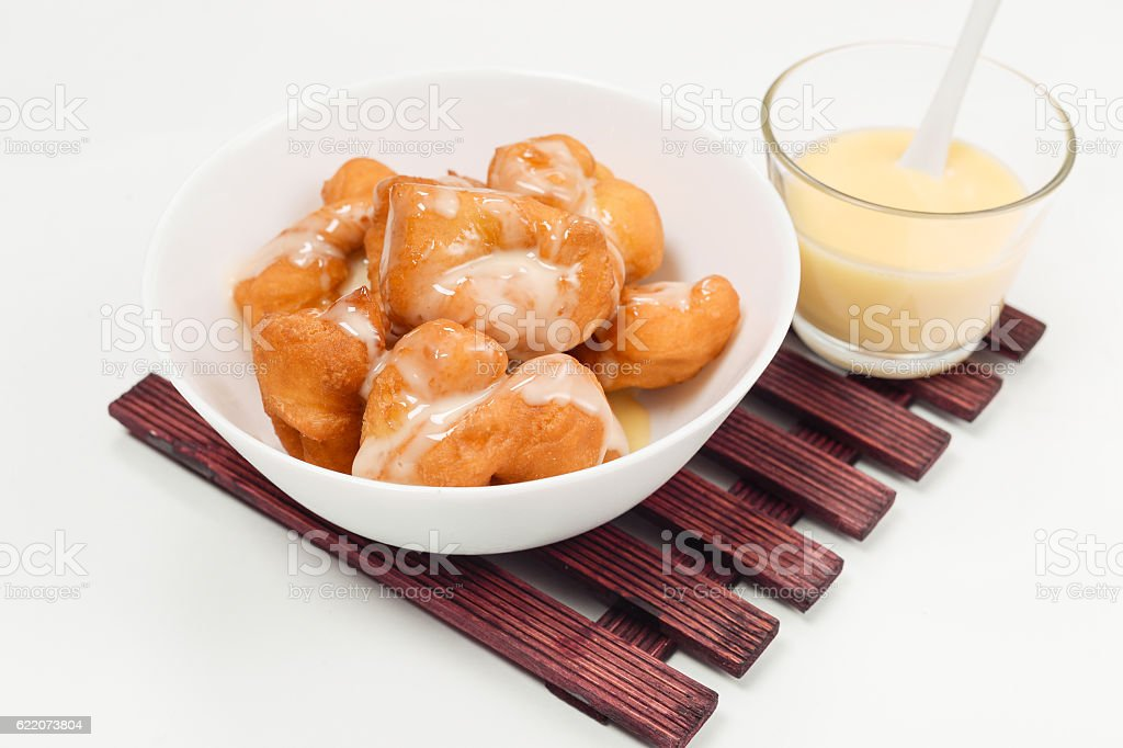 Bread (deep fried dough stick) and Sweetened condensed milk stock photo