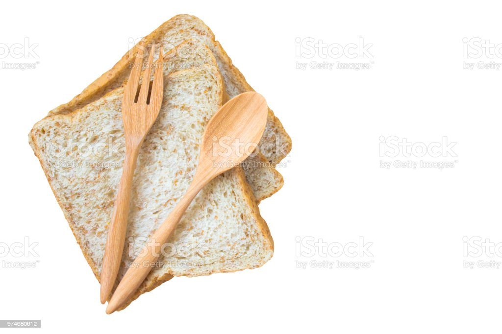 bread and wood spoon  isolated on white background / copy space / top view. clipping path included stock photo