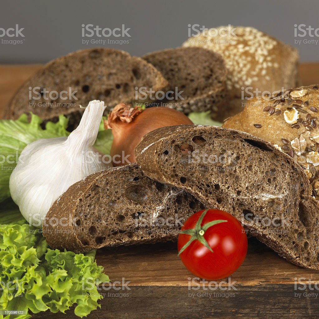 Bread assortment and vegetables royalty-free stock photo