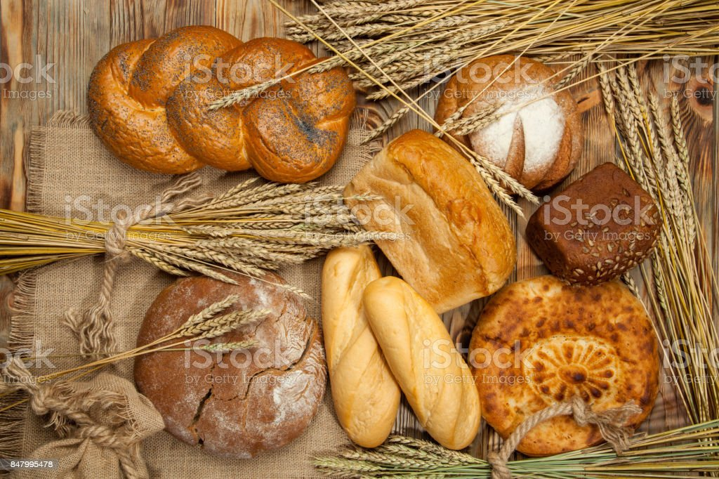 Bread assortment on background of the old canvas stock photo