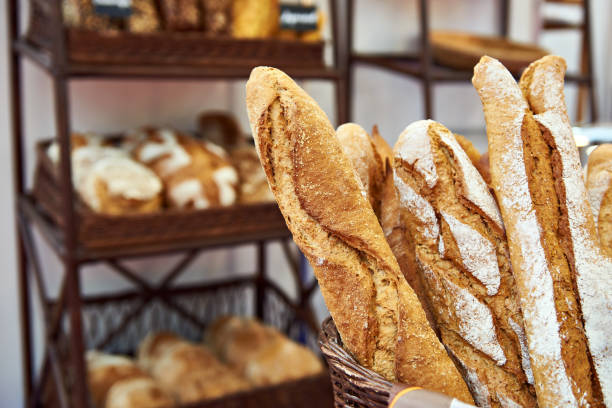 Bread baguettes in basket at baking shop stock photo