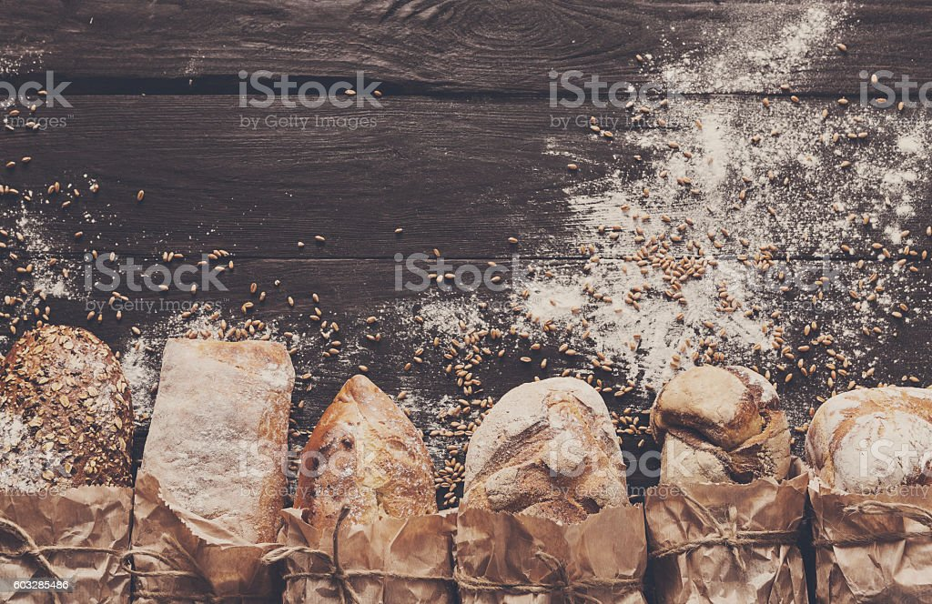 Bread bakery background. Brown and white wheat grain loaves composition stock photo