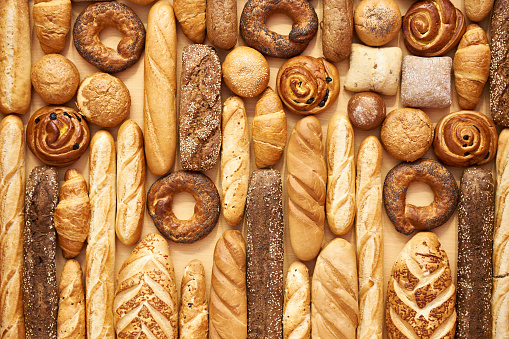 Bread baking rolls and croissants as a background