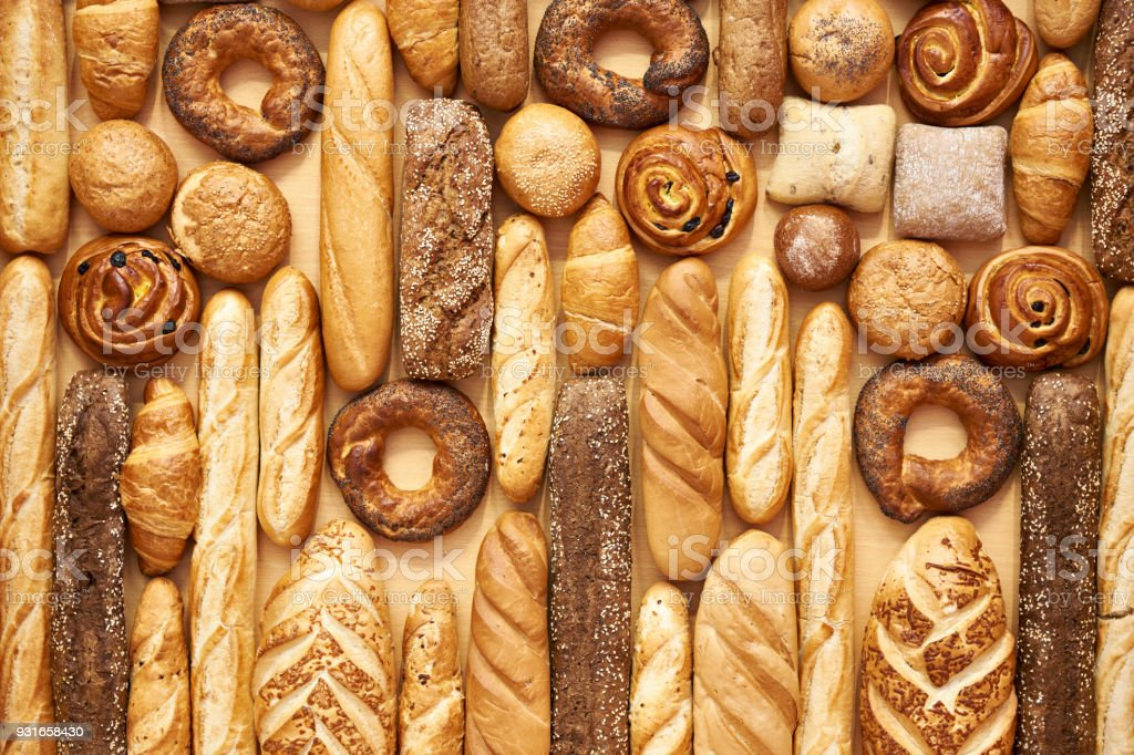 Bread baking rolls and croissants stock photo