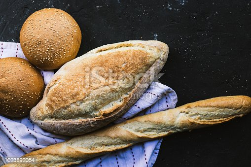 istock Bread border on dark background 1023892054