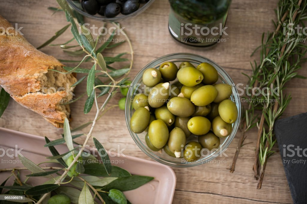 bread ciabatta and bowl of green olives zbiór zdjęć royalty-free