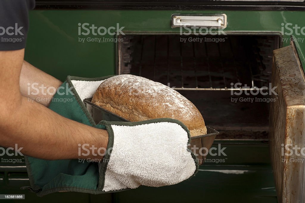Bread coming out of oven royalty-free stock photo