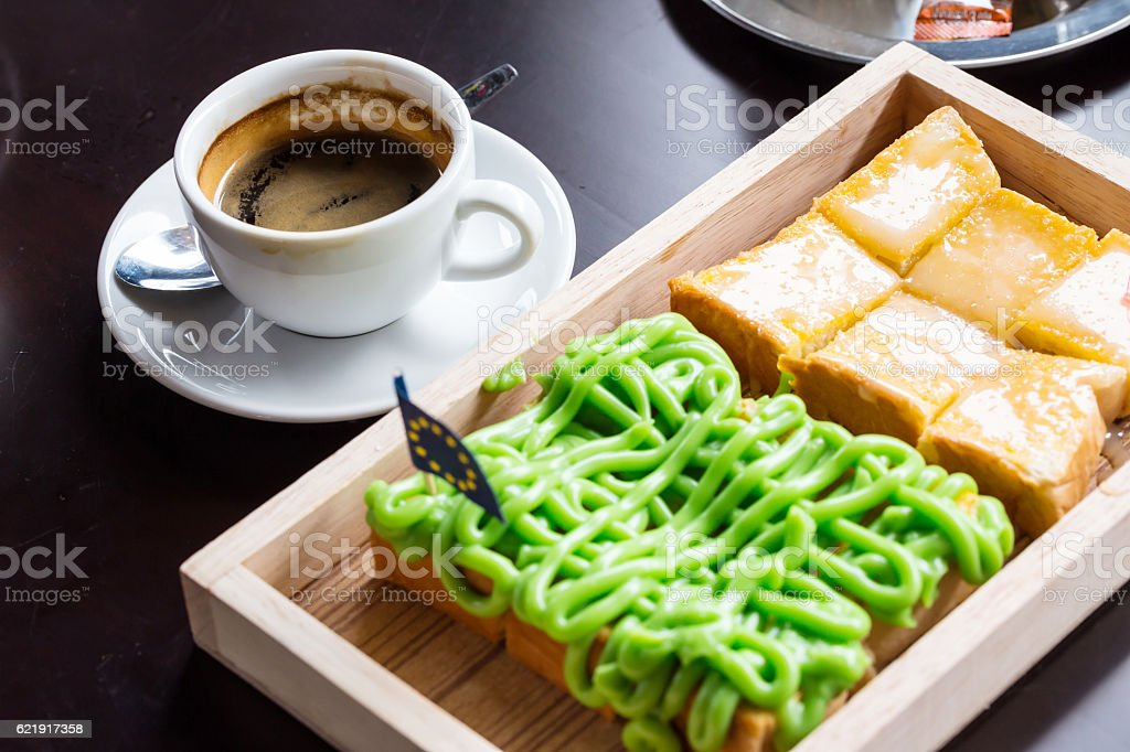 Bread custard on wooden plate and coffee stock photo