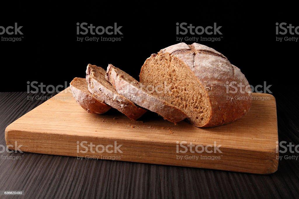 bread, cut on an oak board stock photo