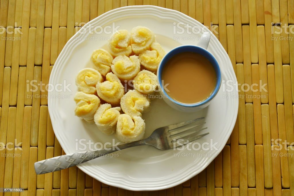 bread filled butter roll with coffee royalty-free stock photo