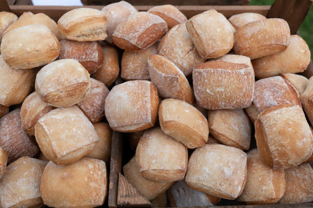 Bread in heaps in a wooden box. Mixed fresh breads. stock photo